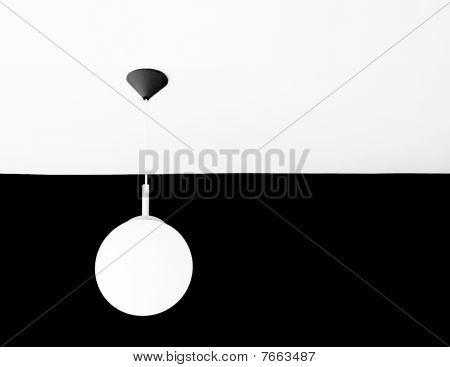 White Lamp On White Ceiling Facing Black Wall