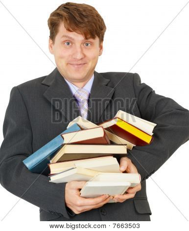 Happy Man Holding Pile Of Books