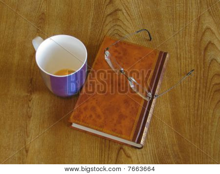 Cup, book and glasses
