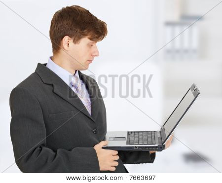 Engineer Works With Laptop On Hands