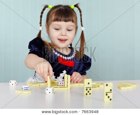 Child During The Game At Table
