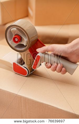 Packaging parcels with dispenser close-up