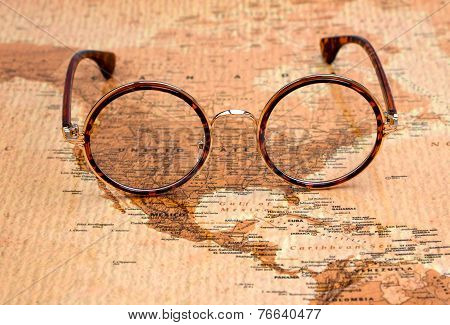 Glasses on a map of a world - United States
