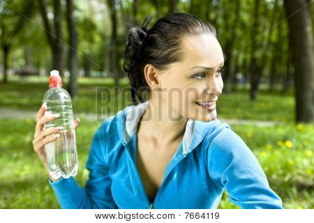 Happy Woman With Bottle
