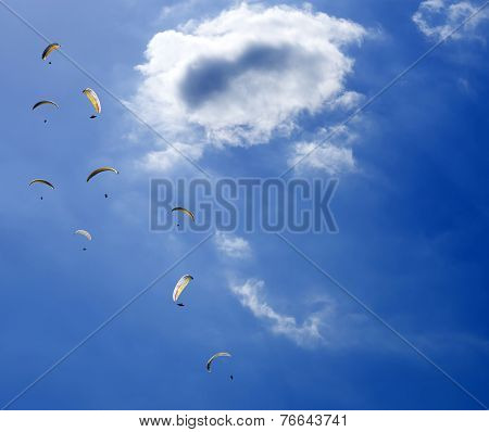 Paragliders Gliding...