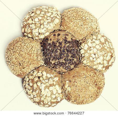 multigrain brown bread in shape of flower isolated