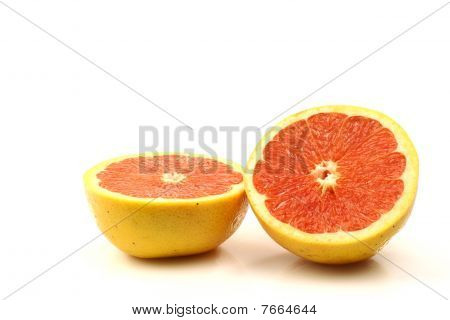 fresh and juicy red grapefruit halves