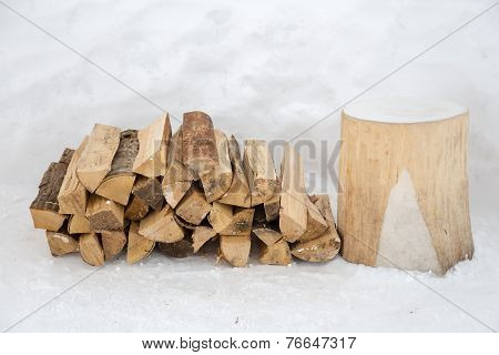 Dry Firewood In Snow Background