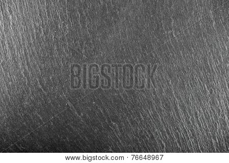 Table slate background close up at high resolution