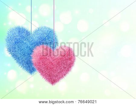 Blue and pink fluffy hearts pair on blue bokeh background