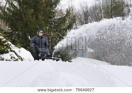 Man Clearing Snow During Winter Storm