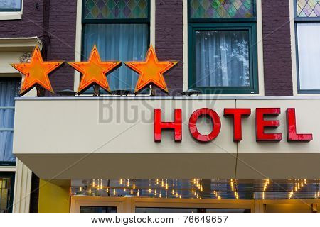 Three stars real hotel sign