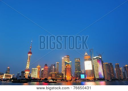 SHANGHAI, CHINA - JUNE 2: Crowded urban skyscrapers at dusk on June 2, 2012 in Shanghai, China. Shanghai is the largest city by population in the world with 23 million as in 2010.
