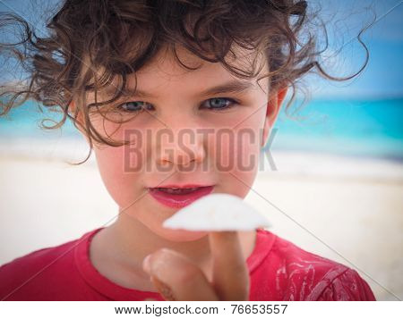 Girl Holding Shell On Beach