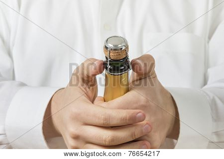 Waiter Opening A Botle Of Champagne