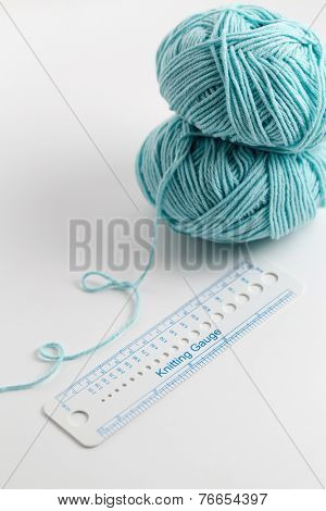 Knitting accessories, gauge ruler and ball of wool