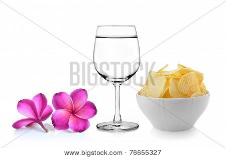 Glass Of Water  Frangipani Flower , Bowl Of Potato Chips On White Background