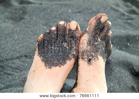 Feet in black sand range