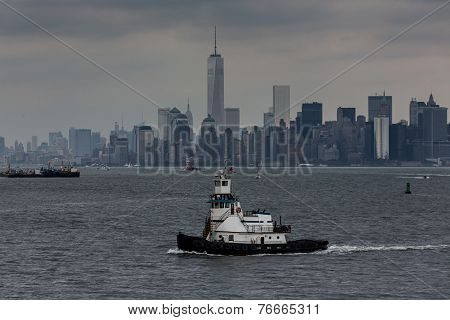 Tugboat With New York Skyline In Background