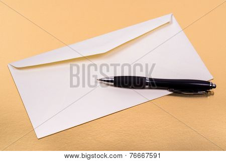 Unsealed White Envelope With A Ballpoint Pen On The Side