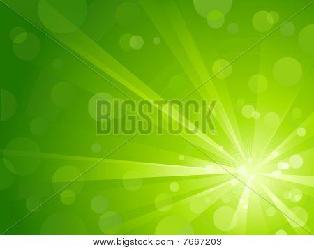 Explosión de luz verde con puntos de luz brillantes