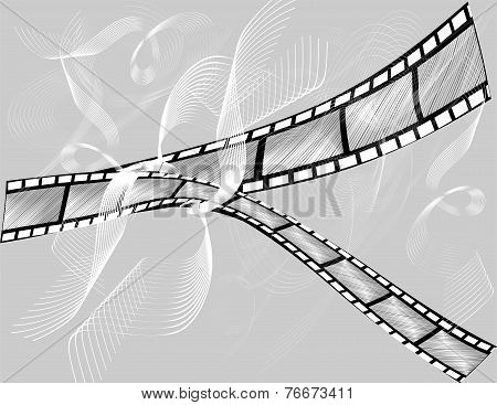 Two Pieces Of A Film On A Gray Background
