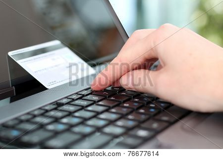Young Business Woman  Entering  Data Of  A Credit Card . On-line Shopping On The Internet Using A La