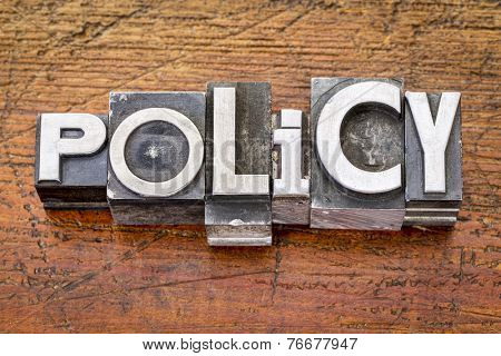 policy word in vintage metal type printing blocks over grunge wood