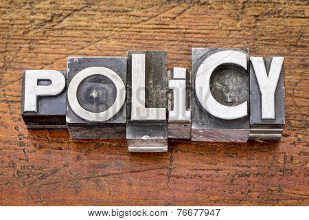policy word in vintage metal type printing blocks over grunge wood