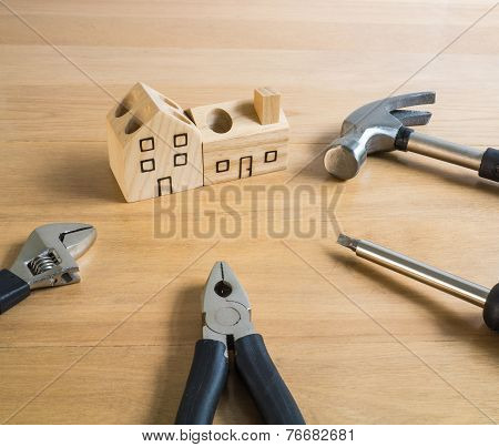 Set of tools and handmade wood house toy.