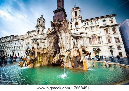 Rome, Italy - November 17, 2014: Tourists visit Piazza Navona with fountain  in Rome, Italy. Rome is of the most visited city in Europe and world