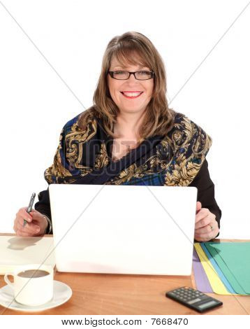 Businesswoman Seated With Laptop