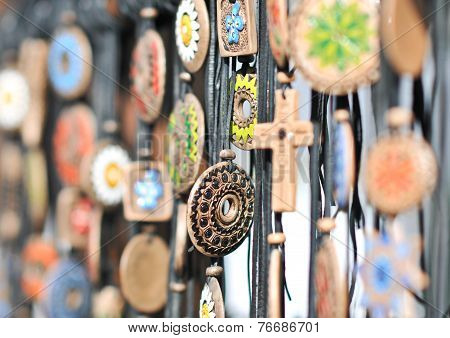 Various necklaces at souvenir market in Romania, close up. Traditional cultural neck-lets