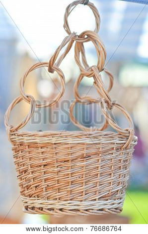 Handmade basket for sale at a souvenir market in Romania. A hanging woven basket for flower pot