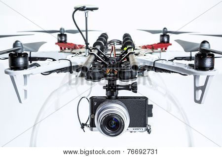 FORT COLLINS, CO, USA, November 21,  2014:  A prosumer camera (Panasonic Lumix GM1) mounted on DJI  F550 Flame Wheel hexacopter drone. The drone assembled from a kit is ready for aerial photography.