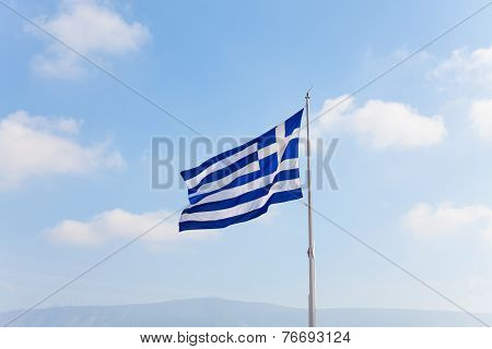 Greek flag with sky in Athens, Greece