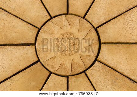 Sun Design On Golden Coloured Paving Stone Star Pattern.  Background Or Texture.
