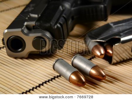 Bullets, magazine, and gun muzzle