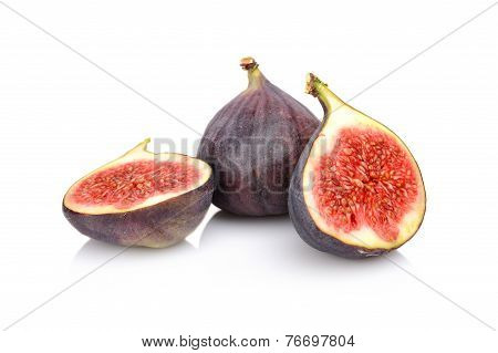 Three Sliced Figs Isolated On White Background