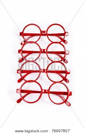 Stack Of Red Glasses Isolated On White