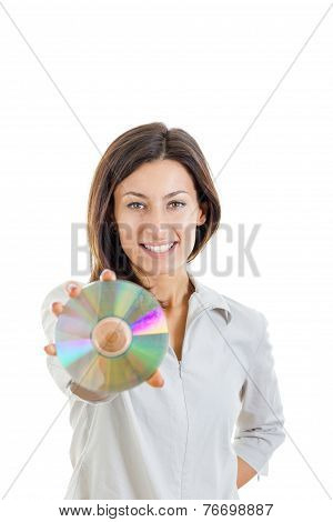 Beautiful Caucasian Casual Smiling Woman Holding Up Compact Disc Or Cd