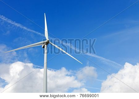 Wind turbine generator on top a hill for the production of clean and renewable energy near Fafe, Portugal