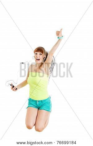 Girl With Earphones Jumping Of Joy Listening To Music