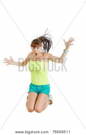 Surprised Beautiful Cute Young Woman Or Girl In Blank Green T-shirt And Shorts Jumps With Face Expre