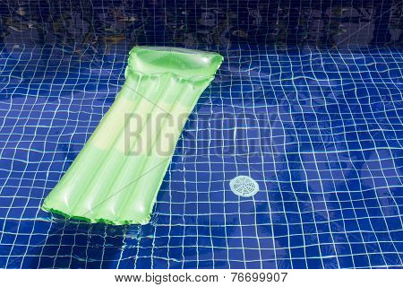 Inflatable Raft Floating In Swimming Pool