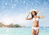 stock photo of sunburn  - Young and beautiful girl on a beach in exotic country - JPG