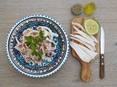 pic of squid  - Marinated squid salad with fresh parsley in the traditional Tunisian plate - JPG
