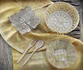stock photo of handicrafts  - thai handicraft on yellow fabric on wooden background - JPG
