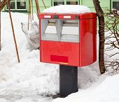 pic of postbox  - A traditional red japanese postbox at winter time covered in snow - JPG