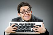 picture of computer hacker  - Computer geek with computer keyboard - JPG